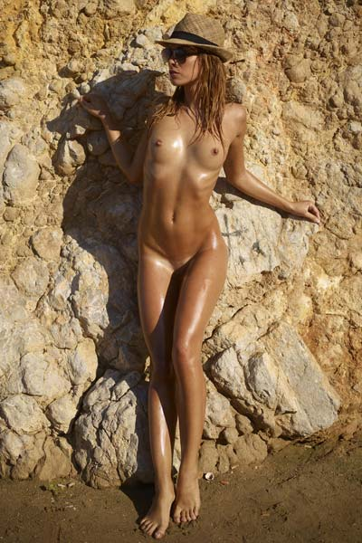 Amazing Amber is oiled up and ready to pose
