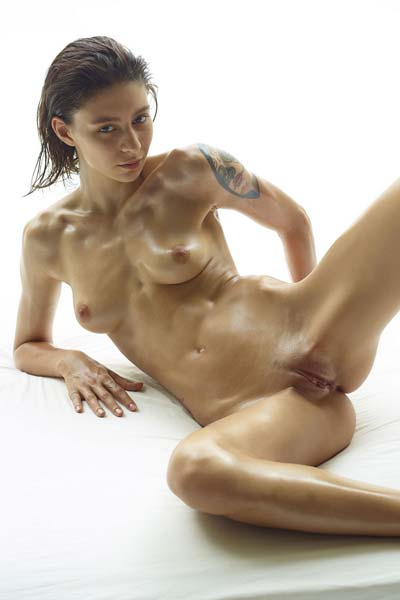 Beautiful Rose is naked and oiled up