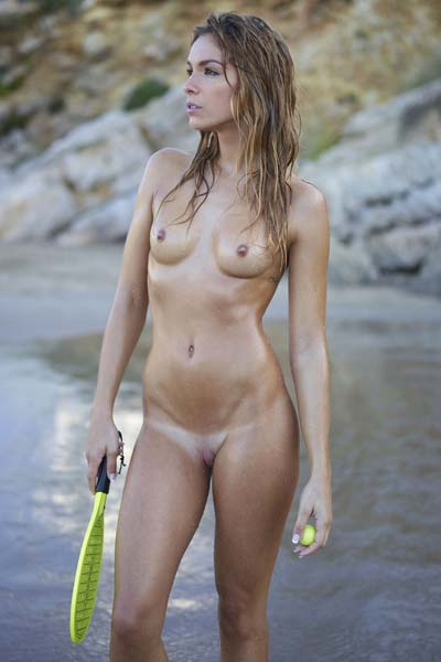 Lovely Amber wants to play some tennis on the beach