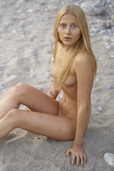 Natural blonde beauty Aleksandra poses in the sand