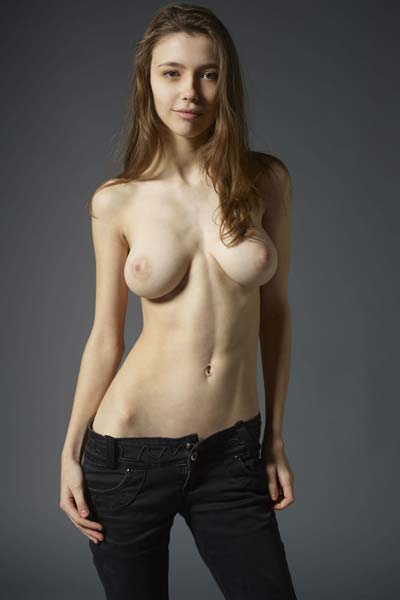 Milla slowly steps in the nude erotically