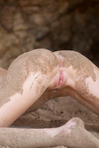 Naked and sexy Katia gets dirty in the beach sand