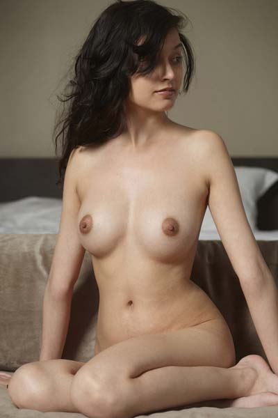All natural busty babe Eden is nude on the couch