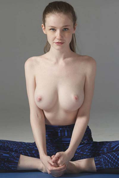 Emily Bloom practices yoga and strips slowly