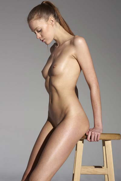 Emma shows off her naked body on the bar stool
