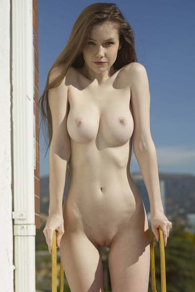 Pale and busty Emily Bloom poses completely naked