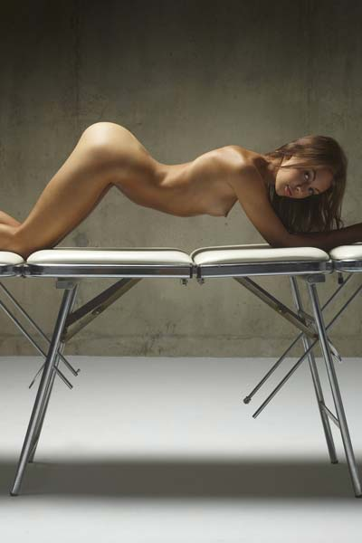 Sexy Karina poses nude on the massage table