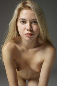 Young and naughty blonde Margot presents her naked curvy body sensually
