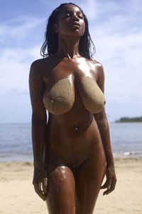 Day on the beach with a busty Ebony babe Kiky turns into sexual seduction