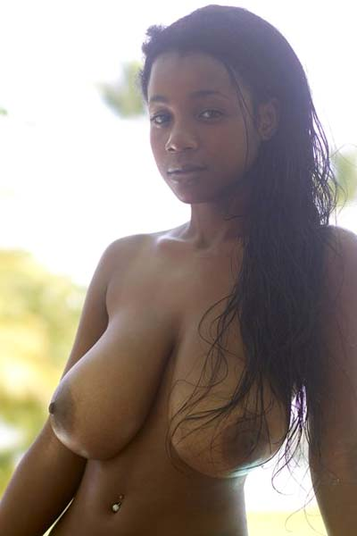 Busty Ebony Kiky showcases her amazing curvy body sensually in front of her house