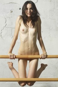 Sultry ballerina Olivia stretches her legs and shows off her shaved beaver