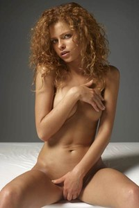 Flirty curly babe poses naked provocatively and displays her perfectly shaped body