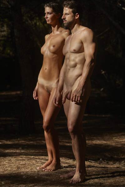 Amazing babe with her smooth tanned body and seductive look poses naked in the forest with her lover