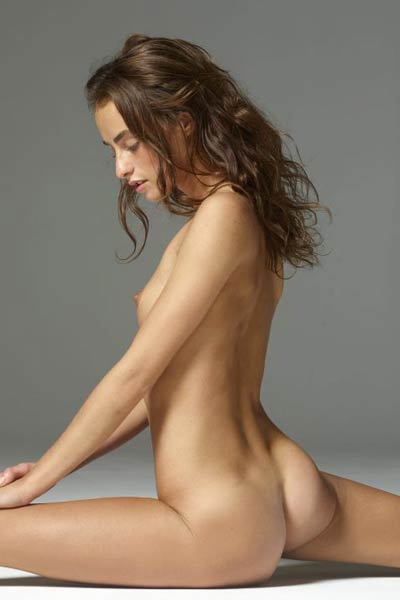 Sexy gimnast flaunts her slim naked figure for a magazine