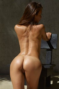 She turns her back and presents her peachy tanned ass