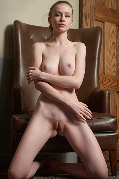 Pale babe with an amazing body parts her thighs and shows off her pink meaty cunt