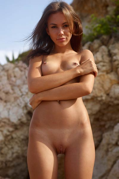 Lovely Karina enjoys being naked on the sandy beach hoping that someone will catch her