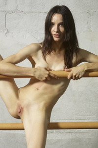 Magnificent Olivia stretches her slender body to shows us some sexy moves