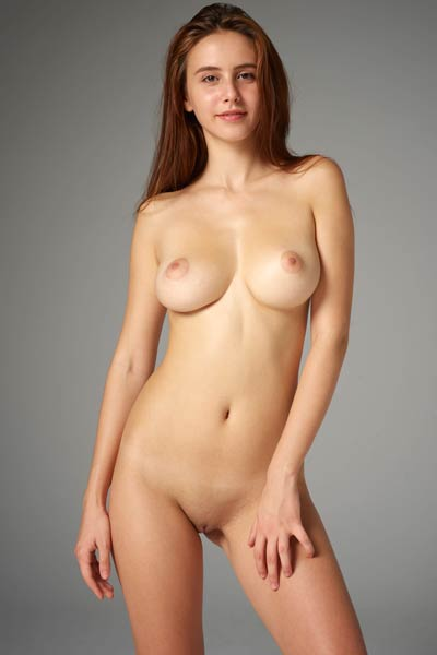 Lovely brunette Alisa shows off her perfect pair of natural tits for a photo shoot