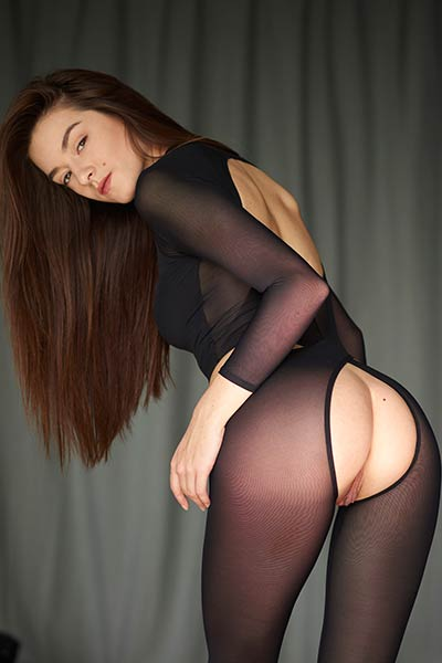 Gorgeous Arina teasing packed in sexy transparent black bodysuit