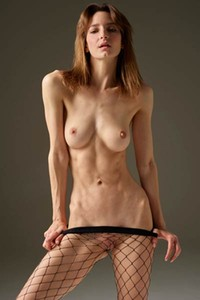 Flora is one hot and skinny babe who enjoys showcasing her sex appeal