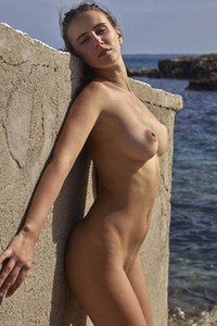 Ibiza is a way hotter when this brunette is striping off and posing naked