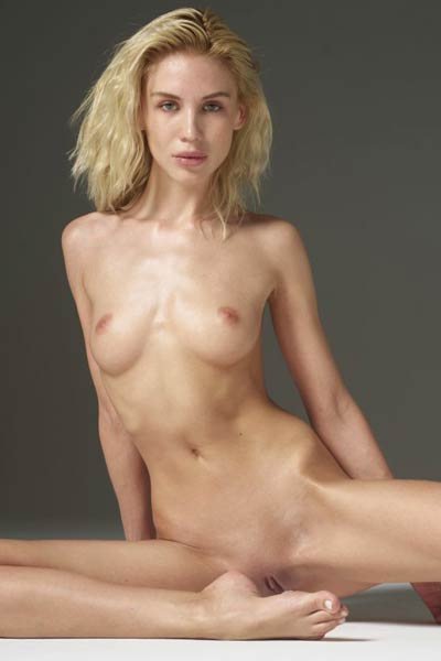 How hot this amazing blonde is posing and showing her body for you
