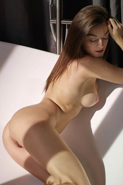 Beautiful doll shows off her stunning body and shaved pussy as she poses completely naked