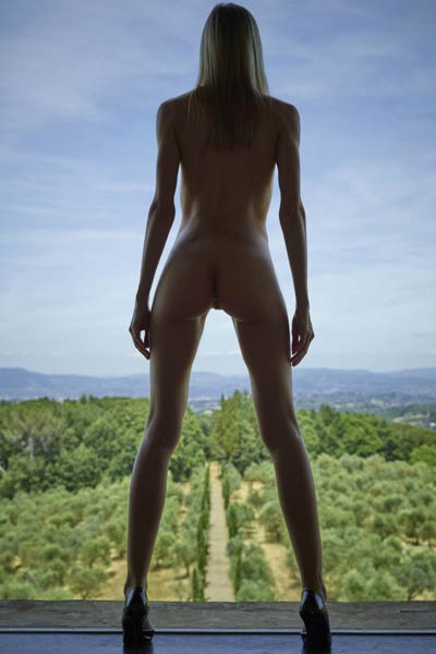 Francy bares her sexy slender body tight butt and hot pussy as she poses on a countryside