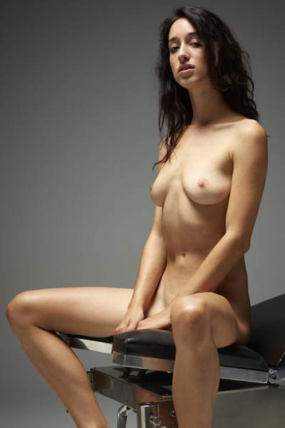 Spooky dark haired chick with amazing body shows all she has on the gyno chair
