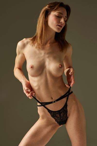 Magnificent Flora shows of her delightful skinny body as she strips her sexy lingerie