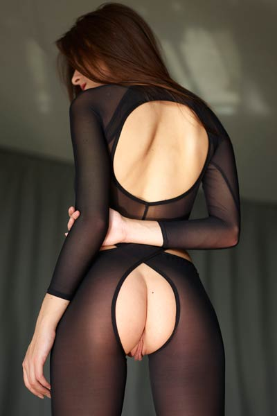 Stunning brunette Arina wants you to see her wide meaty pussy as she poses in sexy outfit