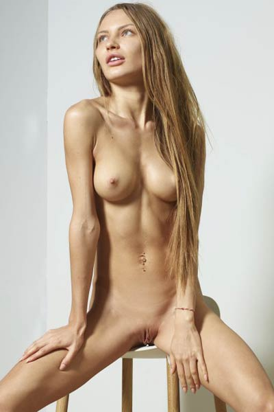 Stunning chick gets nude on the chair and shows off her sex assets