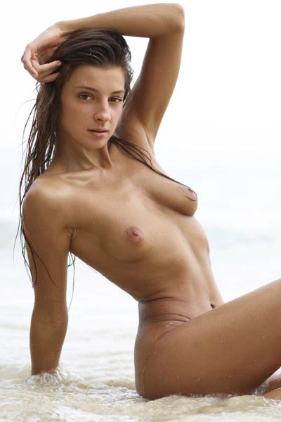 Stunning chick gets nude on the beach and teases with her sexiness