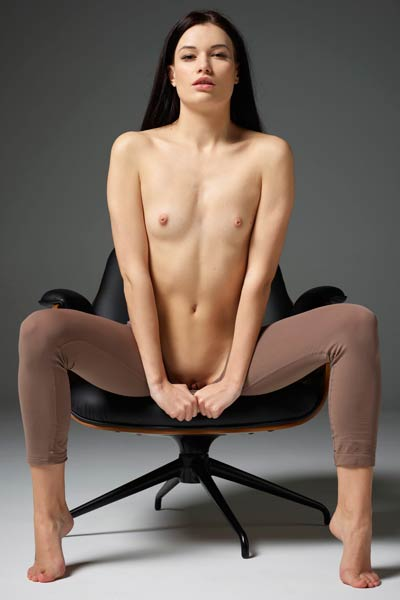 Stunning chick Grace shows her assets as she sits in the chair