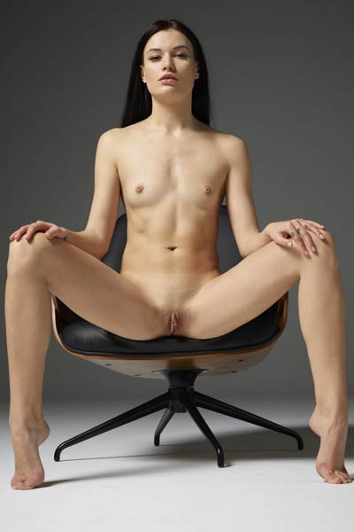 Lustful chick strips everything off her and seductively poses in the chair