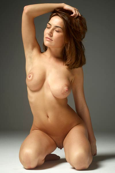 Amazing young lady gets undressed and poses passionately