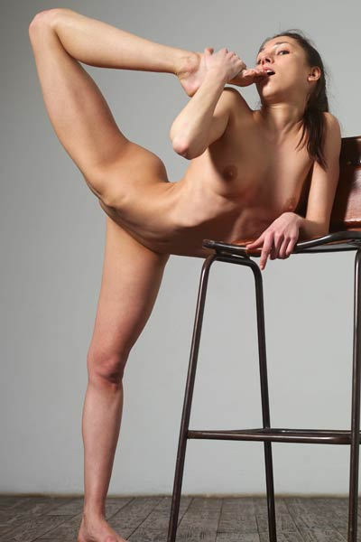 Skinny Eva  showcasing her elastic body on the chair