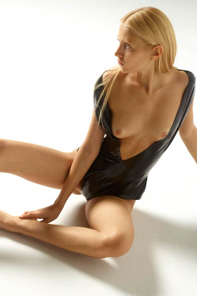 Slim blonde in latex bodysuit Aleksandra gets naked and poses for you