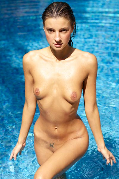 Majestic babe Melena Maria bares her meaty ass as she poses in the pool