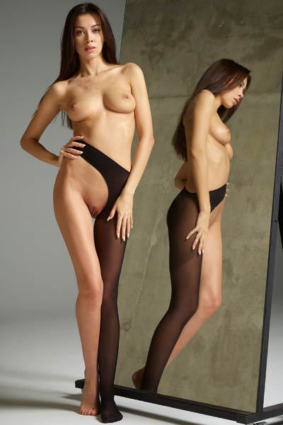 Smoking hot Nicolette stuns everyone with her seductive body as she poses in front of the mirror