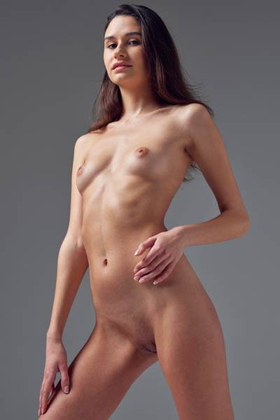 Outstanding slender babe gets nude and dazzles us with her fair skin and perfectly shaved pussy