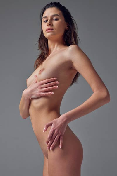 Getting naked and posing is young chick favourite solo action