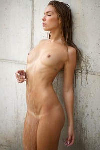 Sexy athletic babe displays her perfect all wet body under the shower