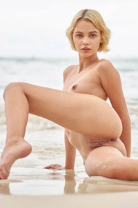 Ariel sexy blonde doll simply adores to spend her time on the beach in nude