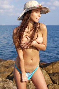 Busty Alisa simply adores to spend her free time on the beach in nude