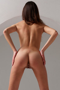Lovely brunette Cristin spreads her legs and shows off her amazing shaved pussy