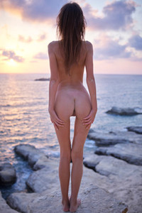Stunning slender babe flaunts her sexy slender body as she poses by the ocean