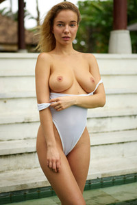 Amazing blonde beauty slips away her bodysuit to show us her gorgeous tits