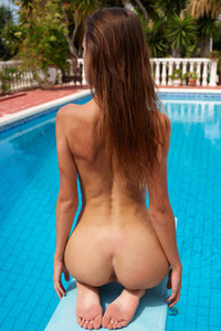 Alice a slim all naked chick shows off her sweet pussy as she sensually poses on the poolside